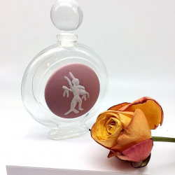 MAGNIFICENT PERFUMERY BOTTLE 75 ML WITH ITS CUPID ANGEL BISCUIT DECOR