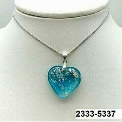 UNIQUE Heart pendant in aquamarine crystal with silver leaf inclusion on chain