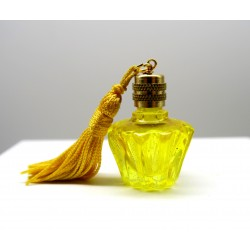 yellow star shaped perfume miniature with pompom